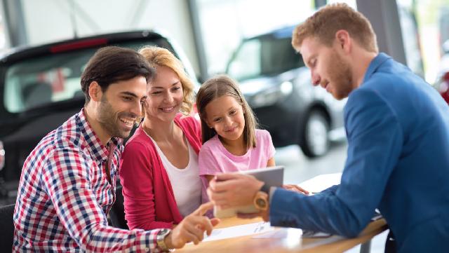 family looking at car options